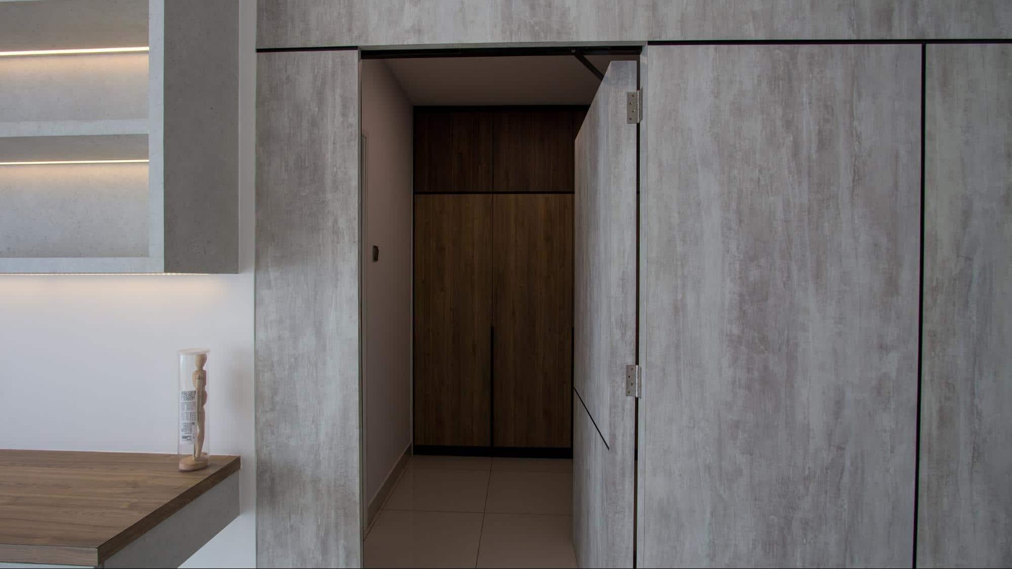Hidden walk-in wardrobe in modern industrial design