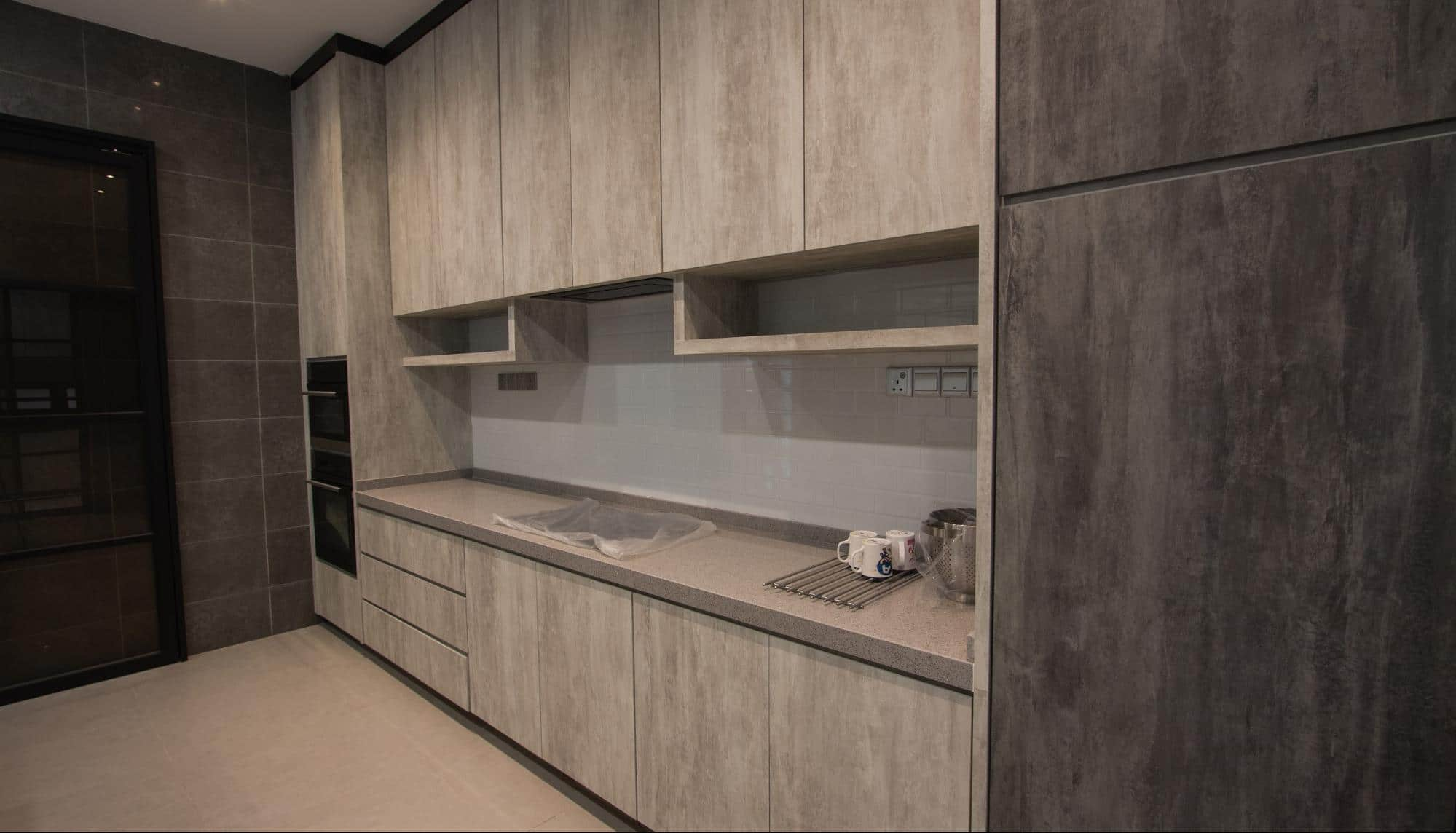 Dry kitchen cabinetry in grey modern industrial tones
