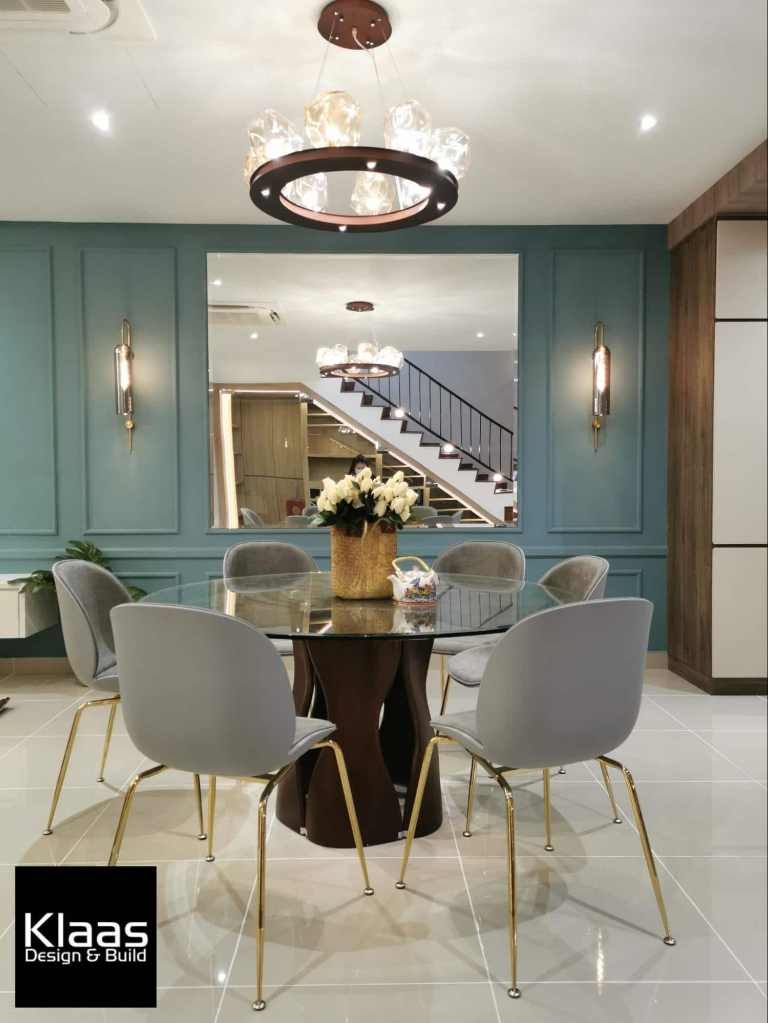Close up of brightly lit dining room with turquoise feature wall