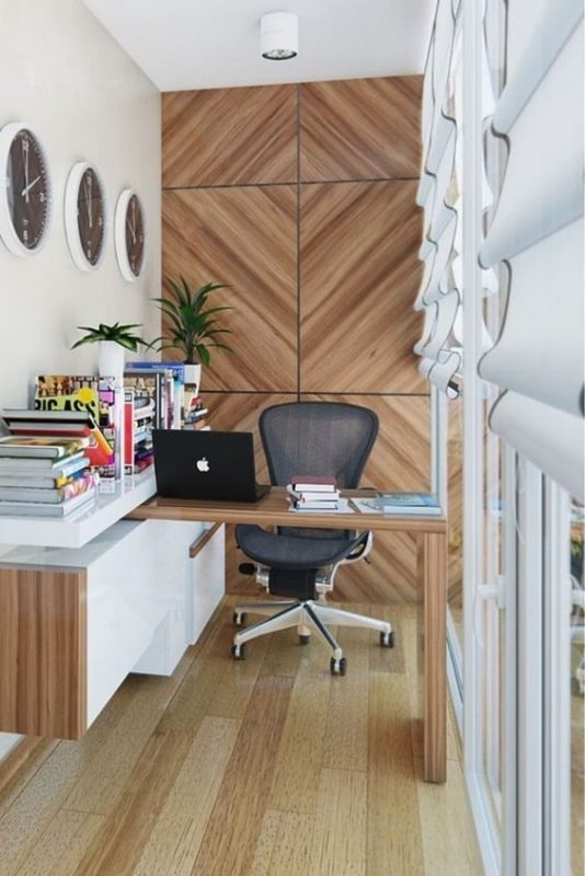 Rotating work desk with laminate feature wall