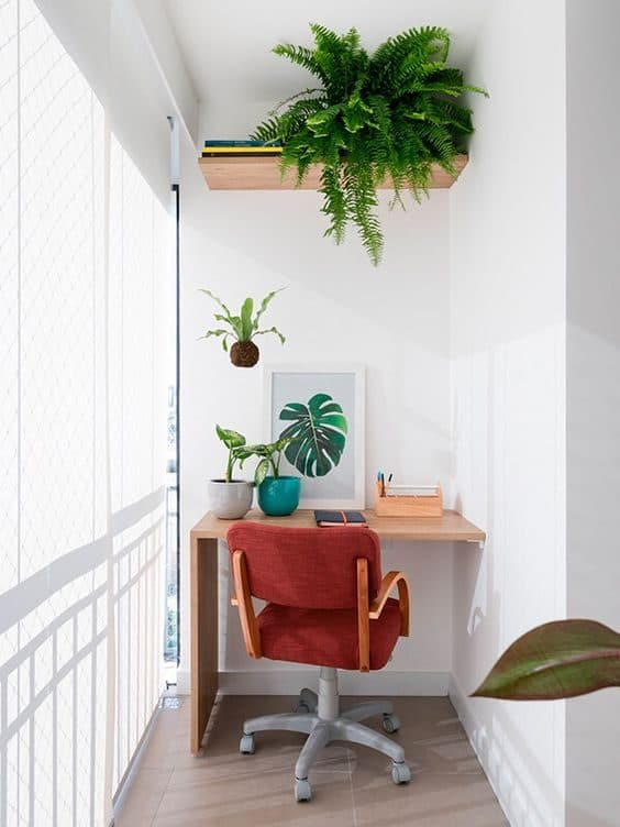 Enclosed balcony makeover with greenery